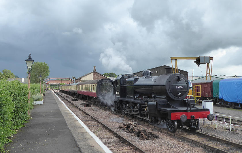 Dark clouds gather as SDJR 2-8-0 no 53808 waits at Williton on 7 June 2019.
